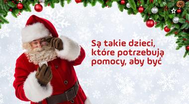 Św. Mikołaj z telefonem w ręku, napis: Są takie dzieci, które potrzebują pomocy, aby być